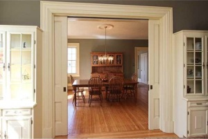 Dining room through enourmous pocket doors