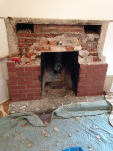 Demo starts on the existing brick mantle